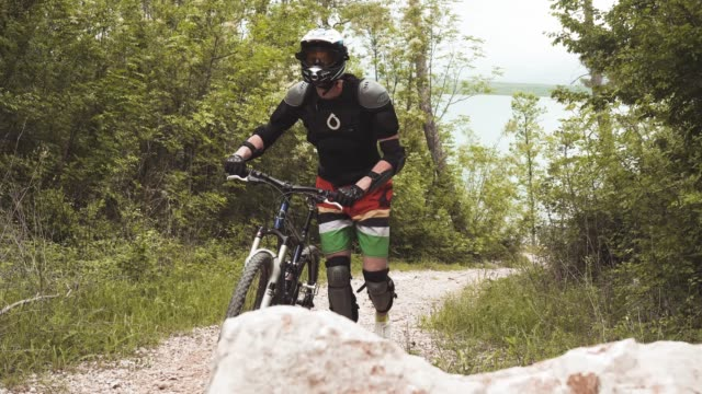 downhill mountain biker pushing his bike - mountain biking stock videos & royalty-free footage