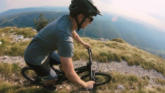 downhill mountain biking on a mountain trail meadow - recreational horseback riding stock videos & royalty-free footage