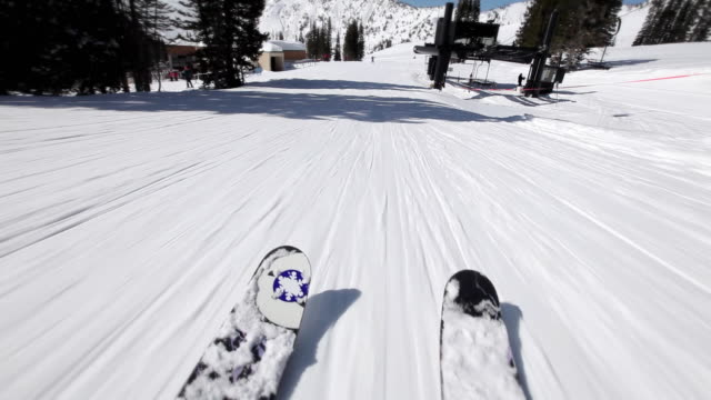 stockvideo's en b-roll-footage met ws pov downhill skiing at ski resort on clear sunny day / alta, utah, usa - alta utah