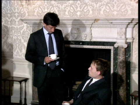 downing st no 11 int man seated in wheelchair chatting / duncan goodhew bends to chat little girl in wheelchair / sebastian coe and others chatting /... - bob monkhouse stock videos & royalty-free footage