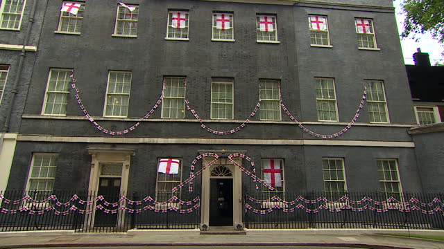 downing street bedecked in st georges cross flag in support of england football team in euro 2020 - national flag stock videos & royalty-free footage