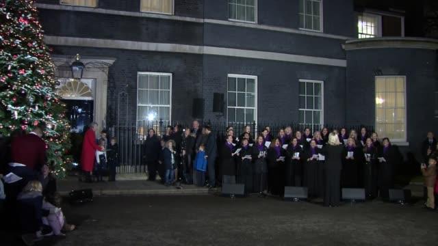 downing street christmas tree lights switch on england london westminster downing street photography** choir singing carol 'o come all ye faithfull'... - choir stock videos & royalty-free footage