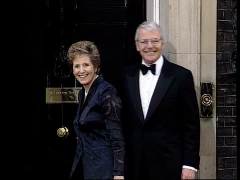downing street dinner itn england london downing street ext some flash photography ms lord callaghan posing with his daughter at door of number 10 ms... - john major stock-videos und b-roll-filmmaterial