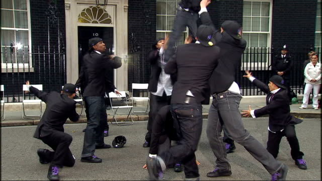 ext 'diversity' performing outside number 10 for gordon brown - britain's got talent stock-videos und b-roll-filmmaterial