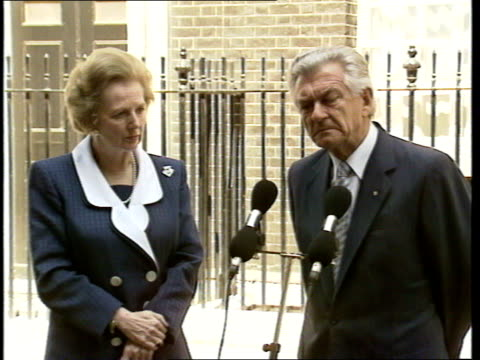07 downing street int hawke and thatcher posing in front of fireplace/ thatcher and hawke seated in front of fireplace/ hawke and thatcher from no... - bob hawke stock videos and b-roll footage