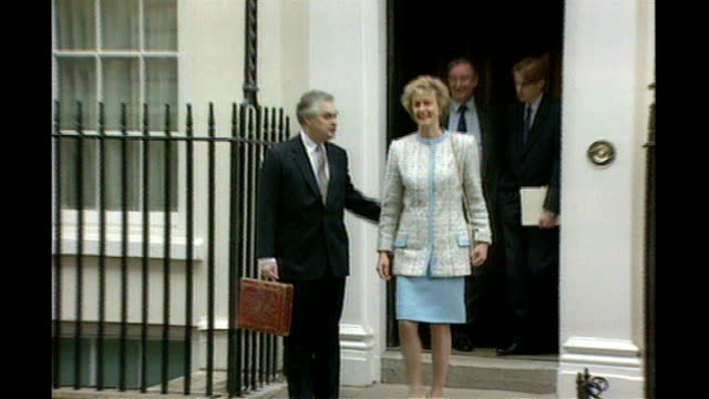 Norman Lamont holding up budget box as wife Rosemary standing next PULL OUT as photocall in session