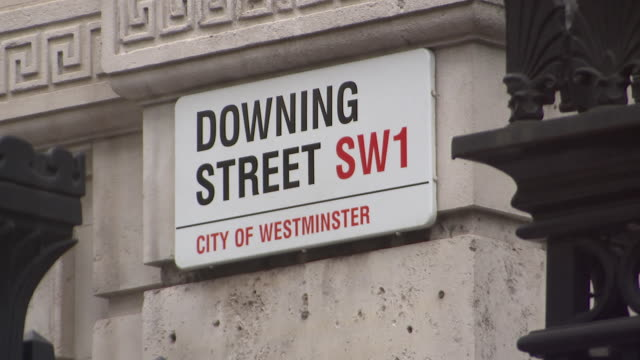 downing street sign in london, england on july 11, 2018. - music or celebrities or fashion or film industry or film premiere or youth culture or novelty item or vacations stock videos & royalty-free footage
