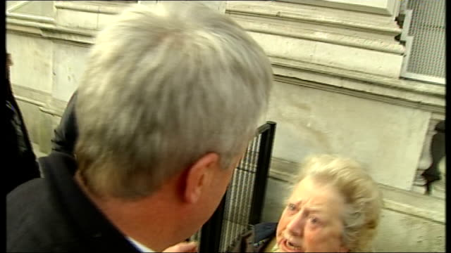 health secretary mobbed by protesters england london westminster ext andrew lansley along / protesters booing and shouting sot / andrew lansley... - nhs stock videos & royalty-free footage
