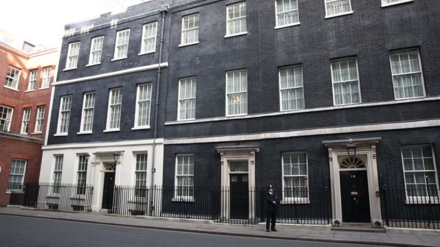 vídeos de stock, filmes e b-roll de downing street, the official residence of david cameron, u.k. prime minister, in london, u.k., on thursday, march 12, 2015 - prime minister