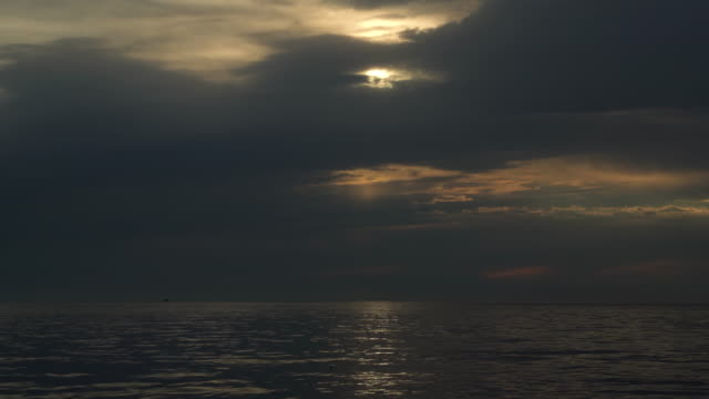 downpressing sky over the sea. - horizon over water stock-videos und b-roll-filmmaterial