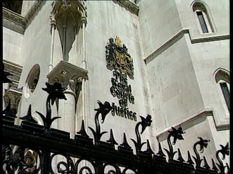 downs syndrome mother c4n clipreel london high court crest on wall pull gv high court seen across road c4n - intellectual disability stock videos & royalty-free footage