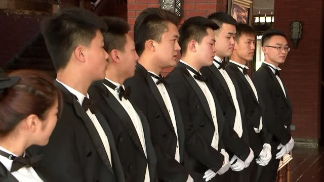 downton abbey inspires boom in demand for butlers china beijing int bowtie of trainee butler being adjusted various of line of trainee butlers at the... - domestic staff stock videos & royalty-free footage