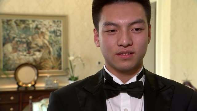 Downton Abbey inspires boom in demand for butlers Various of trainbee butlers serving dinner and high tea Vox pops SOT Various of butlers being...