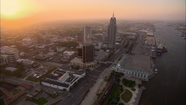 stockvideo's en b-roll-footage met aerial downtown and port of mobile at sunset, mobile, alabama, usa - alabama