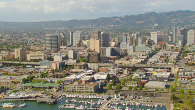 WS AERIAL Downtown and waterfront of Oakland Inner Harbor / Oakland, California, United States