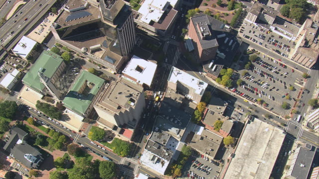 AERIAL Downtown area and rooftops of commercial buildings including Municipal Building / Springfield, Massachusetts, United States