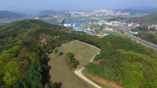 downtown area and royal tomb of king muryeong / gongju-si, chungcheongnam-do, south korea - hill stock videos & royalty-free footage