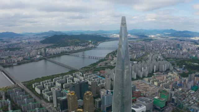 vídeos y material grabado en eventos de stock de downtown area with lotte world tower near han river / jamsil-dong, songpa-gu, seoul, south korea - coreano oriental