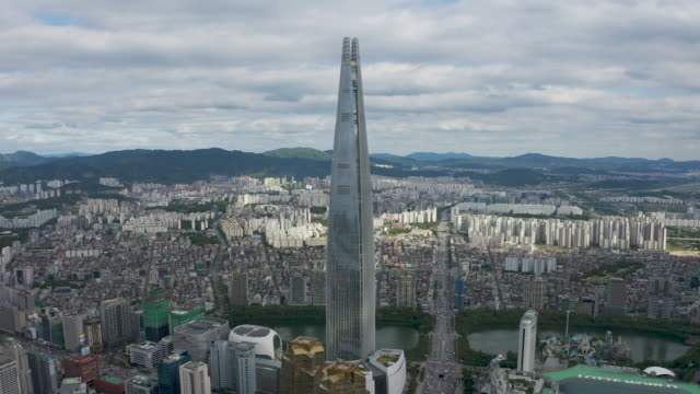 downtown area with seokchon lake, lotte world, lotte world tower / jamsil-dong, songpa-gu, seoul, south korea - tower stock videos & royalty-free footage