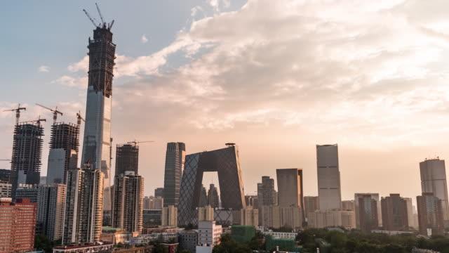 vídeos de stock, filmes e b-roll de t/l tu beijing centro da luz do sol / beijing, china - pequim