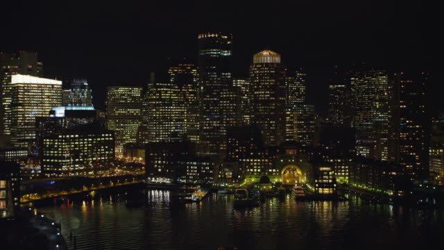 downtown boston at night from the charles river. shot in 2011. - river charles stock videos & royalty-free footage