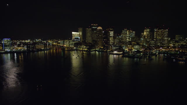 downtown boston from the charles river at night. shot in november 2011. - river charles stock videos & royalty-free footage