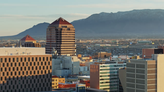 downtown buildings and distant mountains in albuquerque at sunrise - albuquerque new mexico stock videos & royalty-free footage