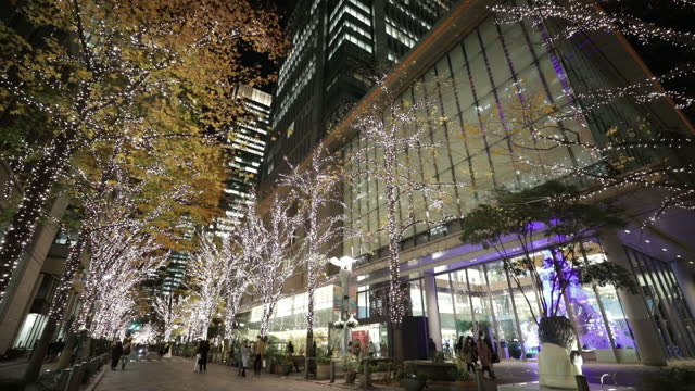 downtown buildings and trees illuminated for christmas at night in marunouchi district in tokyo, japan, on friday, dec. 18, 2020. - downtown stock videos & royalty-free footage