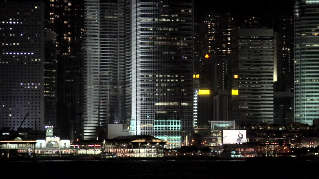 ms tu downtown buildings with international finance centre illuminated at night / hong kong, china - central district hong kong stock videos and b-roll footage