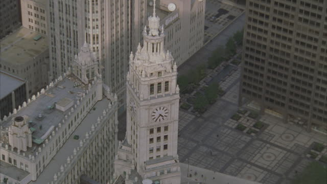 low aerial, downtown buildings with lake michigan in background, chicago, illinois, usa  - michigan avenue bridge stock videos and b-roll footage