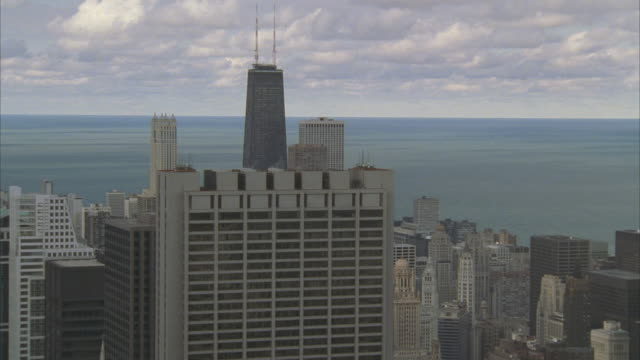 LOW AERIAL, downtown buildings with lake Michigan in background, Chicago, Illinois, USA