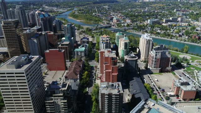 downtown calgary, city and bow river | 4k drone - calgary stock videos & royalty-free footage