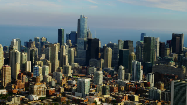 wide aerial side pov downtown chicago with lake michigan in background - two prudential plaza stock videos & royalty-free footage