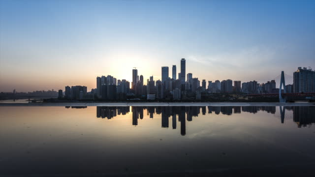 t/l ws la downtown city skyline water reflection dusk to night transition / chongqing, china - sunset to night stock videos & royalty-free footage