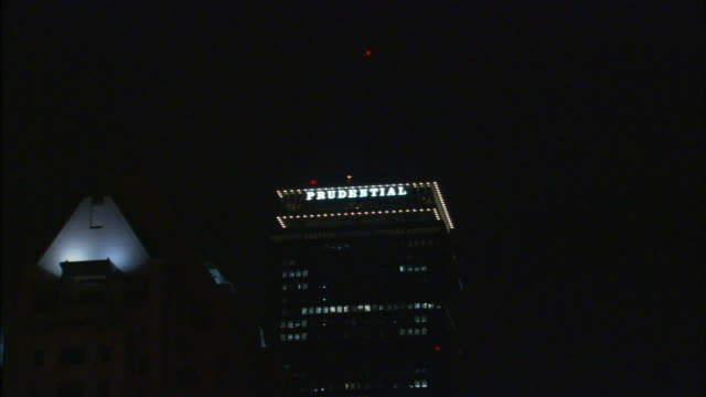 downtown city skyscrapers highrise buildings w/ prudential tower zi prudential tower building lighted sign 52nd floor top of the hub restaurant 50th... - back bay boston stock videos & royalty-free footage