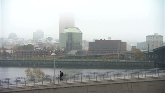 Downtown cityscape in heavy fog Willamette River pedestrian walk bike path FG ZI WS City