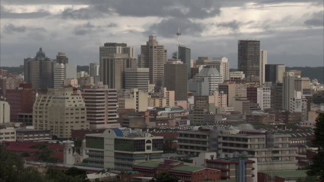WS HA Downtown cityscape with dark clouds above city / Durban, Kwazuzlu Natal, South Africa