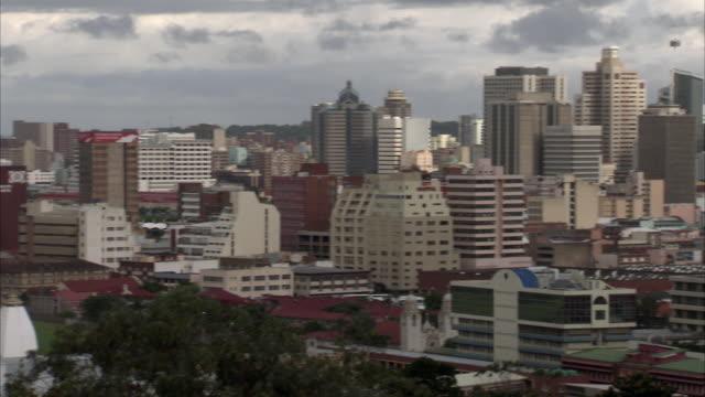 ws ha pan downtown cityscape with dark clouds above city / durban, kwazuzlu natal, south africa - kwazulu natal stock videos & royalty-free footage