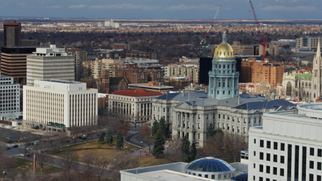 downtown colorado with view of colorado state capitol and the cathedral basilica of the immaculate conception - aerial - basilica stock videos and b-roll footage