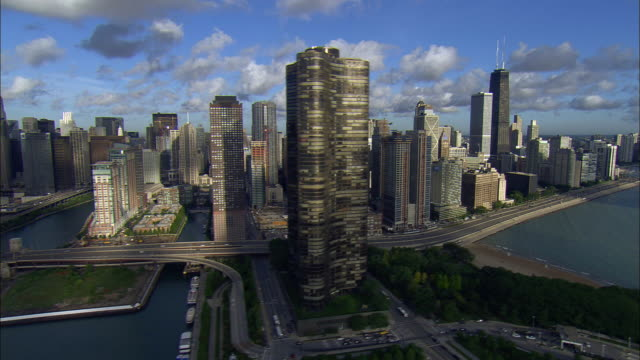 LOW AERIAL, Downtown district and Lake Shore Drive, Chicago, Illinois, USA