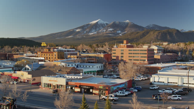 downtown flagstaff, arizona at sunset - aerial - arizona stock videos & royalty-free footage