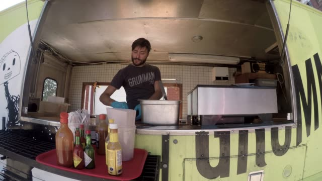 downtown food truck serving client paying contactless street food - mexican food stock videos & royalty-free footage