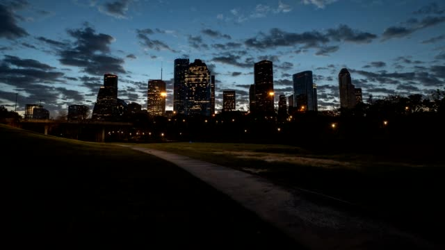 Downtown Houston Buildings at sunrise running trail