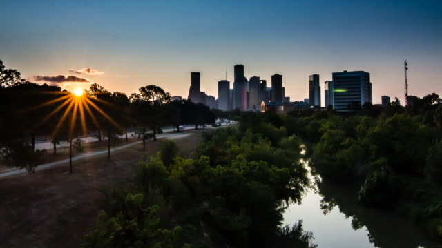 downtown houston sunrise over bayou - thoroughfare stock videos and b-roll footage