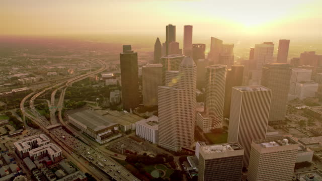 aerial downtown houston, texas basking in the morning sun - gulf coast states stock-videos und b-roll-filmmaterial