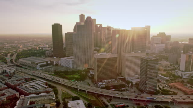aerial downtown houston, texas in sunshine - texas stock videos & royalty-free footage