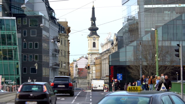 downtown in vienna with church, time lapse - kirche stock videos and b-roll footage
