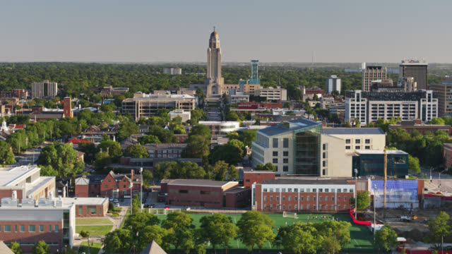 un-l, downtown lincoln and the nebraska state capitol - aerial - nebraska stock videos & royalty-free footage