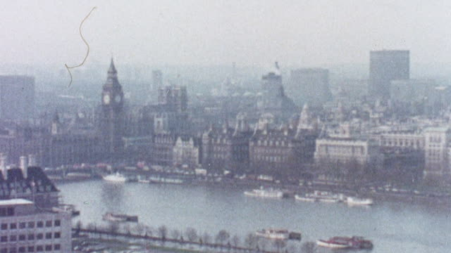 vídeos de stock, filmes e b-roll de 1973 pan downtown london and thames river / london, england - 1973