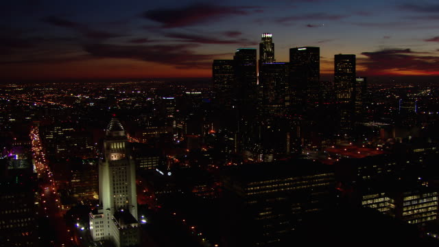 Downtown Los Angeles cityscape with the LA City Hall at night.